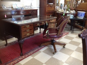 An Elegant and useful solid Mahogany, leather-top desk by Sligh $495. Not too big, not too small. Works nicely with the red leather office chair $65